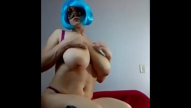 Burlesque teasing showing saggy tits in blue wig
