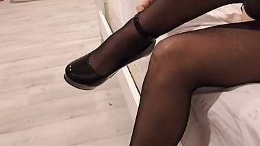 Shoe Dangling and Oiled Feet