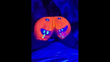 Big Booty in Pumpkin black light paint