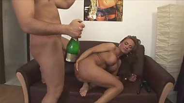 botle of champagne in the ass